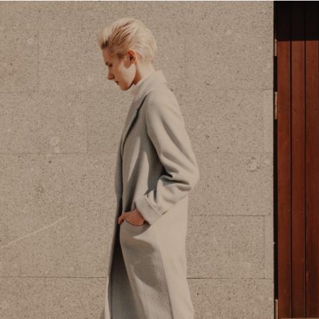 blonde short-hair woman in grey winter coat on street