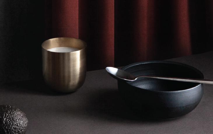 tablescape with cup, bowl, spoon, avocado.