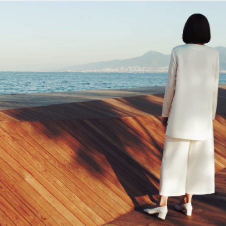 woman in white looking at vista