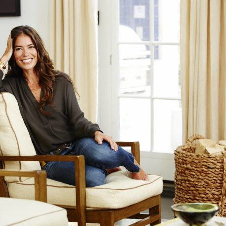 Laura Wasser, founder of It's Over Easy pictured sitting in a living room.