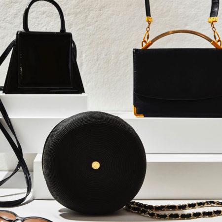 Assorted black handbags