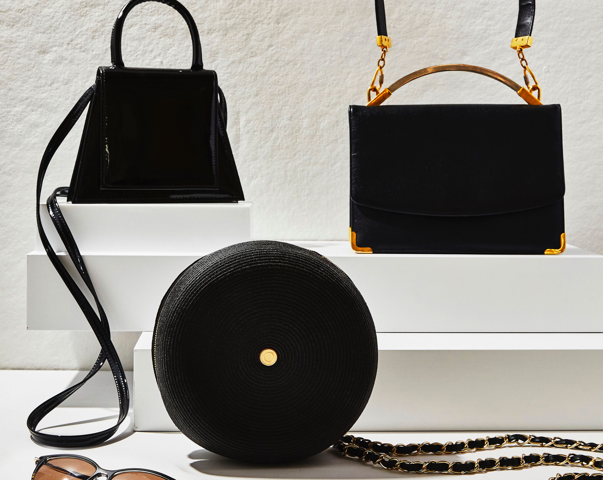 Assorted black handbags